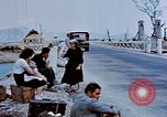 Image of Italian civilians in bombed out town Italy, 1944, second 29 stock footage video 65675051902
