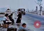 Image of Italian civilians in bombed out town Italy, 1944, second 30 stock footage video 65675051902