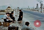 Image of Italian civilians in bombed out town Italy, 1944, second 38 stock footage video 65675051902