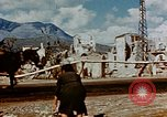 Image of Italian civilians in bombed out town Italy, 1944, second 39 stock footage video 65675051902