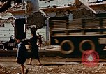 Image of Italian civilians in bombed out town Italy, 1944, second 49 stock footage video 65675051902