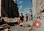 Image of Italian civilians in bombed out town Italy, 1944, second 50 stock footage video 65675051902