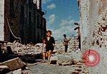 Image of Italian civilians in bombed out town Italy, 1944, second 51 stock footage video 65675051902