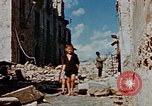 Image of Italian civilians in bombed out town Italy, 1944, second 52 stock footage video 65675051902