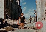 Image of Italian civilians in bombed out town Italy, 1944, second 53 stock footage video 65675051902