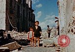 Image of Italian civilians in bombed out town Italy, 1944, second 54 stock footage video 65675051902