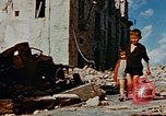 Image of Italian civilians in bombed out town Italy, 1944, second 55 stock footage video 65675051902
