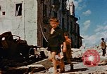 Image of Italian civilians in bombed out town Italy, 1944, second 56 stock footage video 65675051902