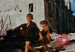 Image of Italian civilians in bombed out town Italy, 1944, second 57 stock footage video 65675051902