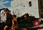 Image of Italian civilians in bombed out town Italy, 1944, second 58 stock footage video 65675051902