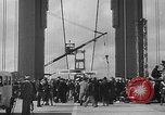 Image of Golden rivet completing the Golden Gate bridge San Francisco California USA, 1937, second 30 stock footage video 65675052024