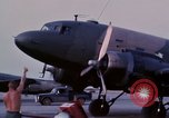 Image of camouflaged AC 47 aircraft Vietnam Bien Hoa Air Base, 1967, second 13 stock footage video 65675052033
