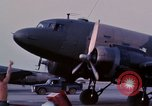 Image of camouflaged AC 47 aircraft Vietnam Bien Hoa Air Base, 1967, second 14 stock footage video 65675052033