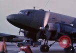 Image of camouflaged AC 47 aircraft Vietnam Bien Hoa Air Base, 1967, second 17 stock footage video 65675052033