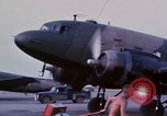 Image of camouflaged AC 47 aircraft Vietnam Bien Hoa Air Base, 1967, second 19 stock footage video 65675052033