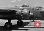 Image of Repair of U.S. C-46 aircraft with help of indigenous people Burma, 1944, second 14 stock footage video 65675052233