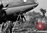 Image of Repair of U.S. C-46 aircraft with help of indigenous people Burma, 1944, second 49 stock footage video 65675052233