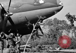 Image of Repair of U.S. C-46 aircraft with help of indigenous people Burma, 1944, second 50 stock footage video 65675052233