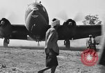 Image of Repair of U.S. C-46 aircraft with help of indigenous people Burma, 1944, second 52 stock footage video 65675052233