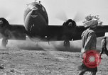 Image of Repair of U.S. C-46 aircraft with help of indigenous people Burma, 1944, second 53 stock footage video 65675052233