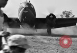 Image of Repair of U.S. C-46 aircraft with help of indigenous people Burma, 1944, second 54 stock footage video 65675052233