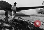 Image of Repair of U.S. C-46 aircraft with help of indigenous people Burma, 1944, second 56 stock footage video 65675052233