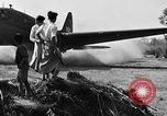 Image of Repair of U.S. C-46 aircraft with help of indigenous people Burma, 1944, second 57 stock footage video 65675052233