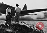 Image of Repair of U.S. C-46 aircraft with help of indigenous people Burma, 1944, second 58 stock footage video 65675052233