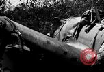 Image of wreckage of Japanese plane Burma, 1944, second 10 stock footage video 65675052238