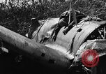 Image of wreckage of Japanese plane Burma, 1944, second 15 stock footage video 65675052238