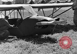 Image of Piper Cub plane Italy, 1944, second 40 stock footage video 65675052266