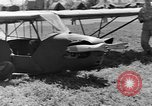 Image of Piper Cub plane Italy, 1944, second 48 stock footage video 65675052266