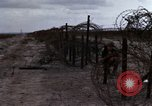Image of United States soldiers Vietnam Bien Hoa Air Base, 1968, second 26 stock footage video 65675052302