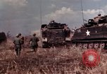 Image of American soldiers in action during Tet Offensive Long Binh, Vietnam, 1968, second 20 stock footage video 65675052311