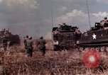 Image of American soldiers in action during Tet Offensive Long Binh, Vietnam, 1968, second 21 stock footage video 65675052311