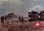 Image of American soldiers in action during Tet Offensive Long Binh, Vietnam, 1968, second 24 stock footage video 65675052311