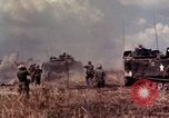 Image of American soldiers in action during Tet Offensive Long Binh, Vietnam, 1968, second 25 stock footage video 65675052311