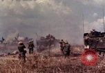 Image of American soldiers in action during Tet Offensive Long Binh, Vietnam, 1968, second 26 stock footage video 65675052311