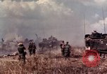 Image of American soldiers in action during Tet Offensive Long Binh, Vietnam, 1968, second 27 stock footage video 65675052311