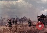 Image of American soldiers in action during Tet Offensive Long Binh, Vietnam, 1968, second 28 stock footage video 65675052311