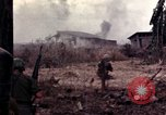 Image of American soldiers in action during Tet Offensive Long Binh, Vietnam, 1968, second 42 stock footage video 65675052311