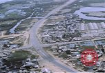 Image of UH-1B helicopter Saigon Vietnam, 1968, second 49 stock footage video 65675052341