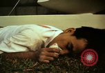 Image of Fallen Vietcong on embassy grounds Saigon Vietnam, 1968, second 10 stock footage video 65675052350