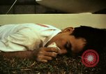 Image of Fallen Vietcong on embassy grounds Saigon Vietnam, 1968, second 19 stock footage video 65675052350