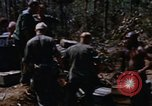 Image of American soldiers at captured VC tunnel complex Vietnam, 1968, second 6 stock footage video 65675052380