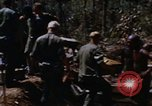 Image of American soldiers at captured VC tunnel complex Vietnam, 1968, second 7 stock footage video 65675052380