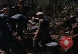 Image of American soldiers at captured VC tunnel complex Vietnam, 1968, second 12 stock footage video 65675052380