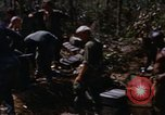 Image of American soldiers at captured VC tunnel complex Vietnam, 1968, second 13 stock footage video 65675052380