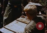 Image of American soldiers at captured VC tunnel complex Vietnam, 1968, second 14 stock footage video 65675052380