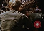 Image of American soldiers at captured VC tunnel complex Vietnam, 1968, second 19 stock footage video 65675052380